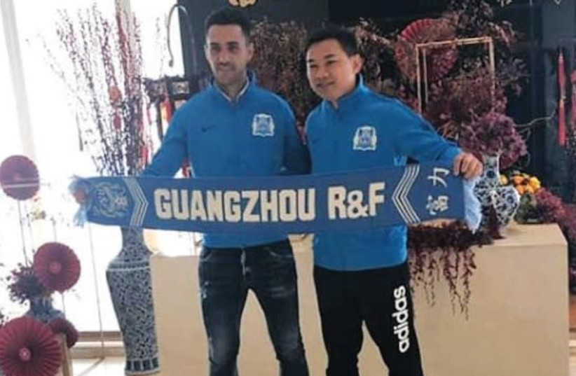 ISRAELI SOCCER STAR Eran Zahavi (left) poses with Guangzhou R&F chairman Zhang Li after inking a lucrative three-year contract extension with the Chinese club. (photo credit: INSTAGRAM)