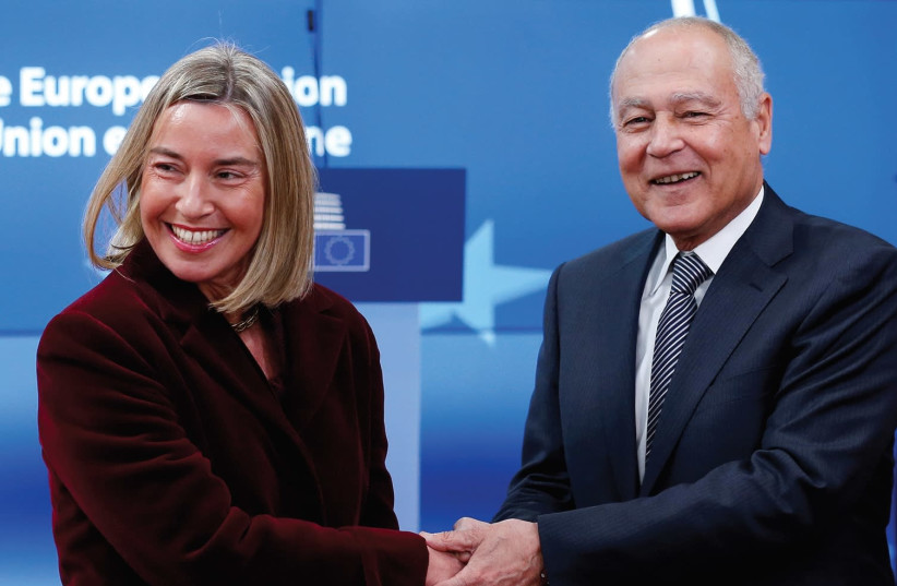 EUROPEAN UNION foreign-policy chief Federica Mogherini welcomes Arab League Secretary-General Ahmed Aboul Gheit ahead of a meeting to discuss the Middle East peace process on February 26th in Brussels. (photo credit: REUTERS/FRANCOIS LENOIR)