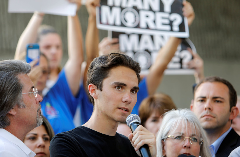 David Hogg, a senior at Marjory Stoneman Douglas High School, speaks at a rally calling for more gun control three days after the shooting at his school (photo credit: JONATHAN DRAKE / REUTERS)