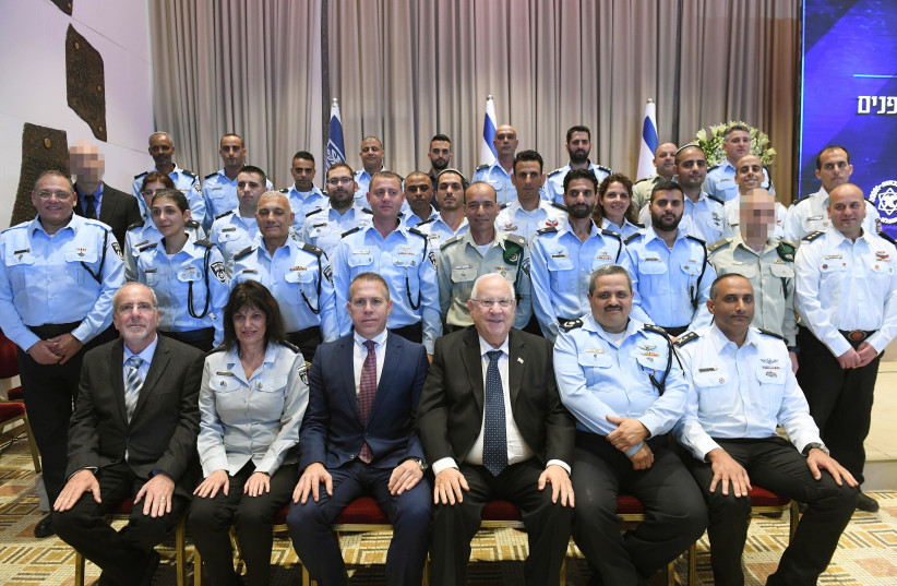 President Reuven Rivlin and Police Commissioner Insp.-Gen. Roni Alsheich meet with honorees on February 27th, 2018. (photo credit: Mark Neiman/GPO)