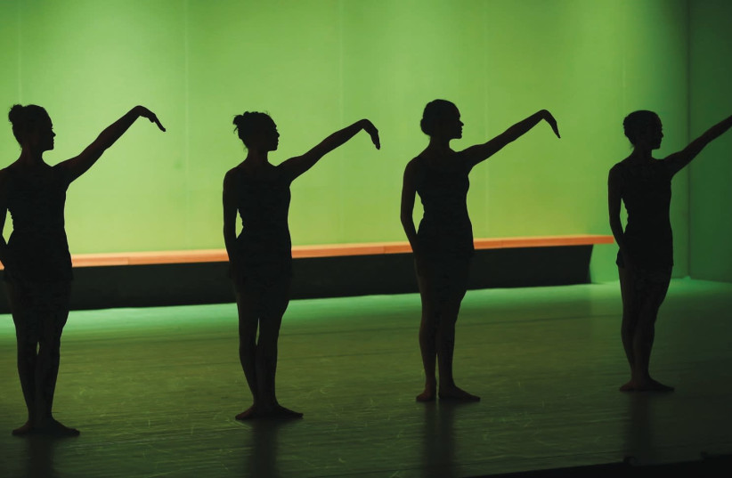 THE DANCERS are clad in simple black outfits and surrounded by fluorescent green walls and lighting – lending the stage an eerie, otherworldly ambience. (photo credit: ASCAF AVRAHAM)