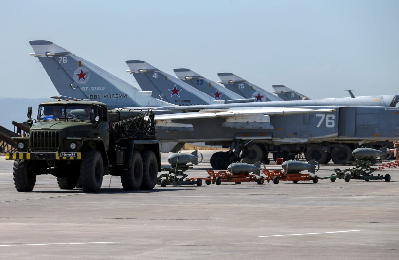 Russian military jets are seen at Hmeymim air base in Syria (photo credit: REUTERS/VADIM SAVITSKY/RUSSIAN DEFENSE MINISTRY VIA REUTERS)