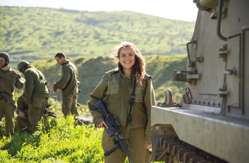 A woman combat soldier poses near the northern border a year ago during a joint exercise involving artillery, infantry and armored brigades (photo credit: EDEN BRIAND/IDF)