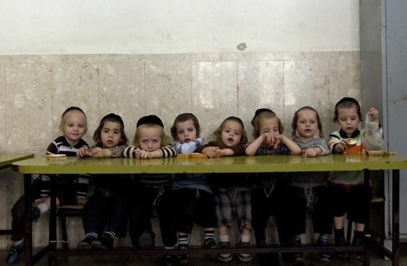 Ultra-Orthodox Jewish children sit in class at the Shomrei HaHoma Torah School for boys in Jerusalem's Mea Shearim neighbourhood November 9, 2010 (photo credit: REUTERS/Ronen Zvulun)