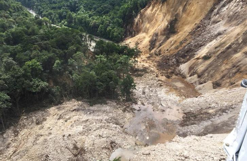 Areas affected by landslides are seen after a powerful 7.5 magnitude earthquake, in Hela, Papua New Guinea February 26, 2018 in this picture obtained from social media. Picture taken February 26, 2018. BERNARD JAMES MCQUEEN /via REUTERS (photo credit: BERNARD JAMES MCQUEEN/VIA REUTERS)