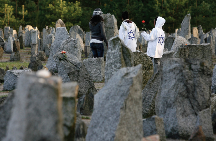YOUTHS STAND among stones at Treblinka Nazi Death Camp memorial. (photo credit: REUTERS)