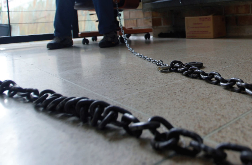 A chain, symbolic of women chained to marriage (photo credit: REUTERS)