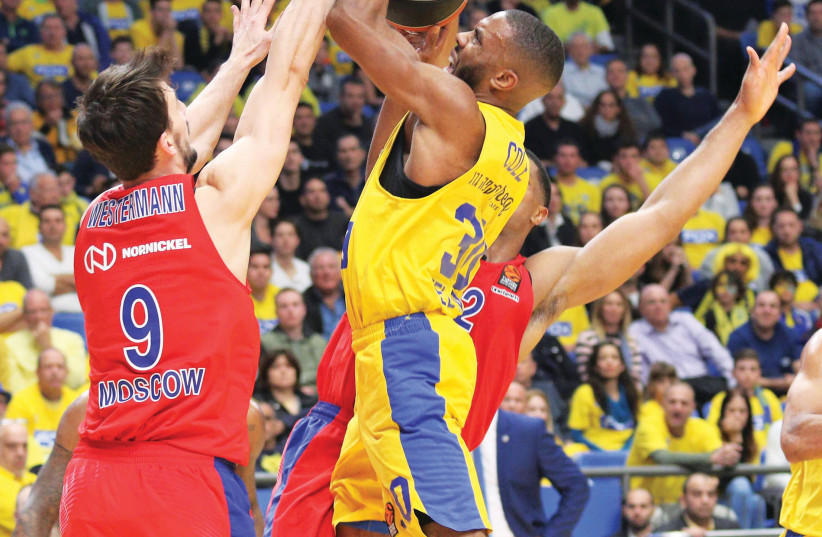 Maccabi Tel Aviv guard Norris Cole (with ball) couldn't find a way through CSKA Moscow's defense last night, with the yellow-and-blue being outplayed by its old rival in a 93-73 defeat in Euroleague action at Yad Eliyahu Arena. (photo credit: ADI AVISHAI)