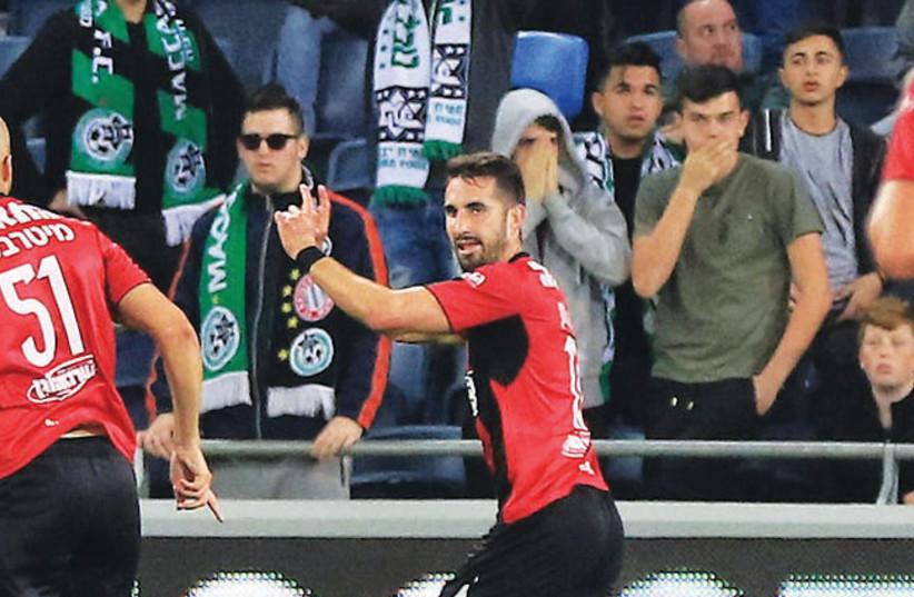 Hapoel Haifa striker Alon Turgeman celebrates after scoring his team's equalizer in last night's 1-1 draw with Maccabi Haifa, sending Hapoel through to the State Cup semifinals (photo credit: ERAN LUF)