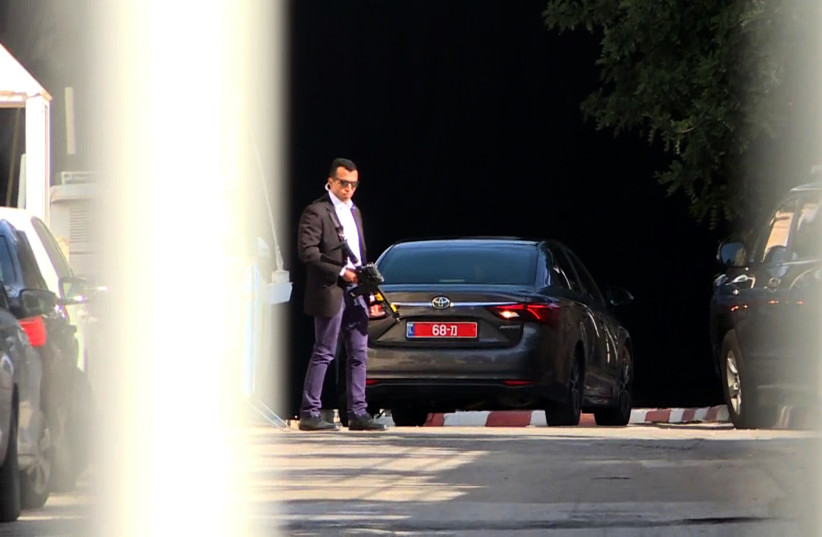 An image grab taken from an AFP video shows a vehicle belonging to the Israeli police at the entrance to the residence of Israeli Prime Minister Benjamin Netanyahu on March 2, 2018. (photo credit: AHIKAM SERI / AFP)