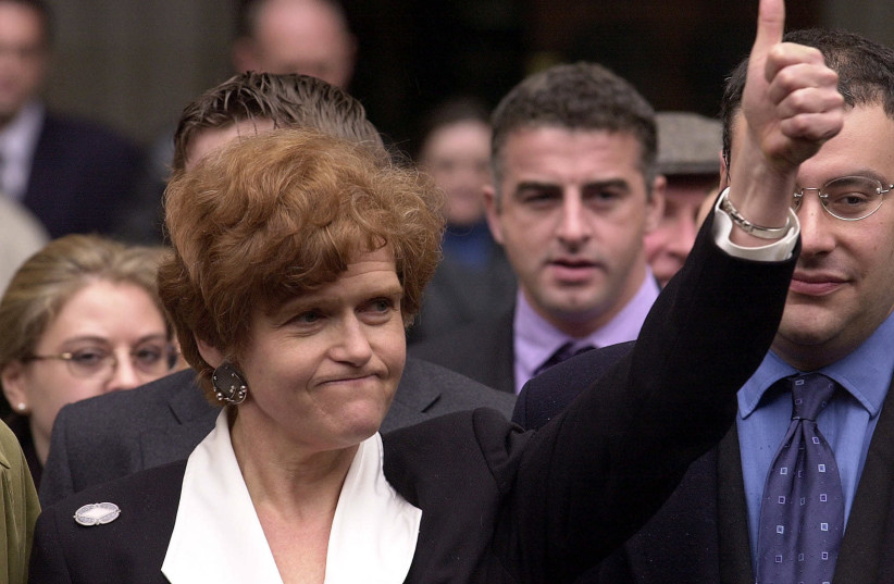 US academic Deborah Lipstadt (C) exults 11 April 2000 the High Court in London after winning a libel case brought against her and Penguin publications by British revisionist historian David Irving. (photo credit: MARTIN HAYHOW / AFP)