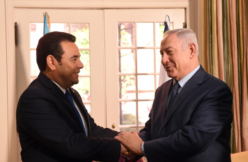 Guatemala president Jimmy Morales meeting Prime Minister Benjamin Netanyahu  (photo credit: HAIM ZACH/GPO)