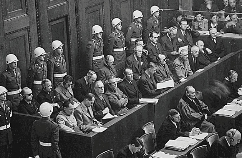 THE DEFENDANTS, including Joachim von Ribbentrop in the front row, sit in the dock at Nuremberg in 1946. (photo credit: REUTERS)