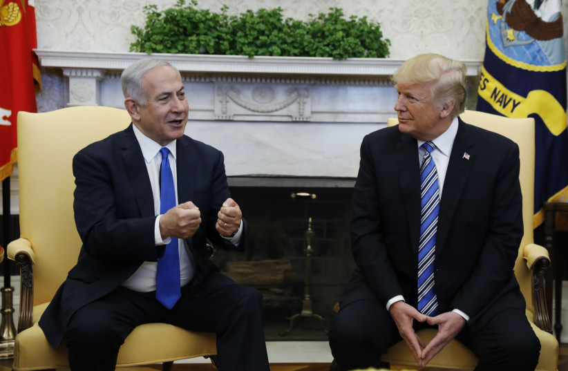 US president Donald Trump said he may come to Jerusalem in May for the formal move of the embassy to Jerusalem.  (photo credit: KEVIN LAMARQUE/REUTERS)
