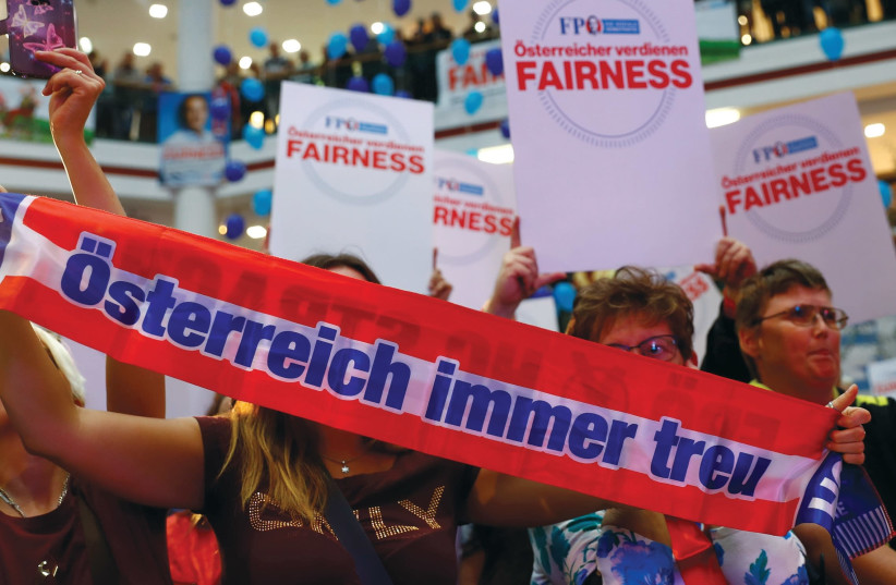 SUPPORTERS WAIT for Heinz-Christian Strache, head of Austria's far-right Freedom Party (FPO), during an election campaign rally in Vienna. (Reuters) (photo credit: REUTERS)