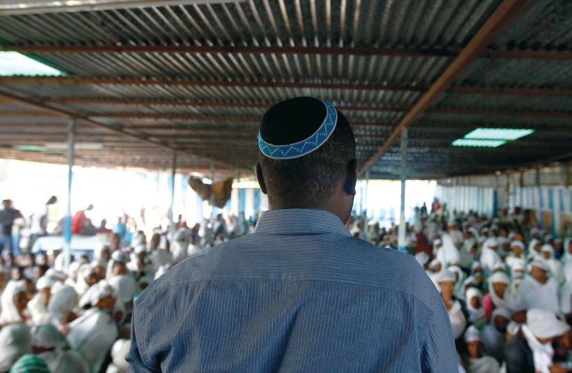 AN ELDER leads members of the Falash Mura Jewish Ethiopian community in a morning prayer service. (Reuters) (photo credit: REUTERS)