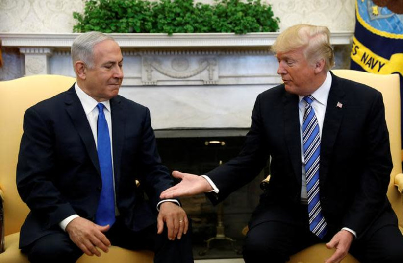 U.S. President Donald Trump meets with Israel Prime Minister Benjamin Netanyahu in the Oval Office of the White House in Washington, U.S., March 5, 2018. REUTERS/Kevin Lamarque (photo credit: REUTERS/KEVIN LAMARQUE)