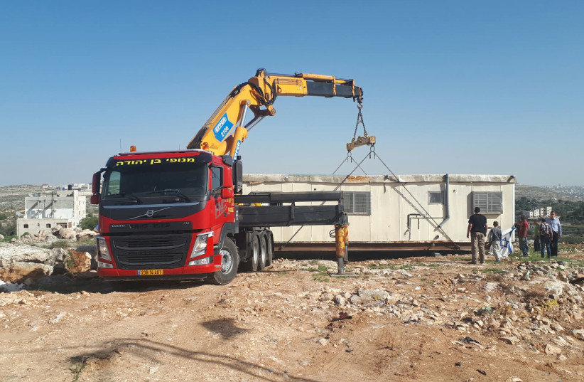The construction of an industrial zone in Kiryat Arba (photo credit: MOSHE BUTBIA/TPS)