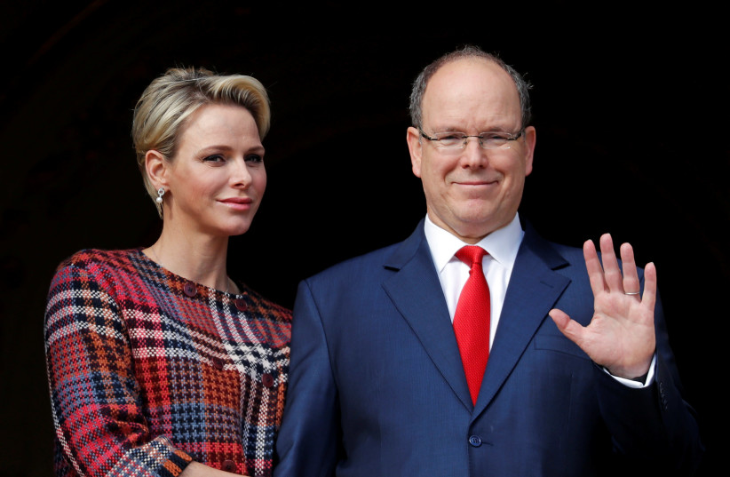 Prince Albert II of Monaco and his wife Princess Charlene stand on the palace balcony during the traditional Sainte Devote procession in Monaco, January 27, 2018.  (photo credit: ERIC GAILLARD/REUTERS)