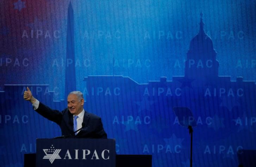 Israeli Prime Minister Benjamin Netanyahu takes the stage to speak at the AIPAC policy conference in Washington, DC, US, March 6, 2018 (photo credit: REUTERS/BRIAN SNYDER)