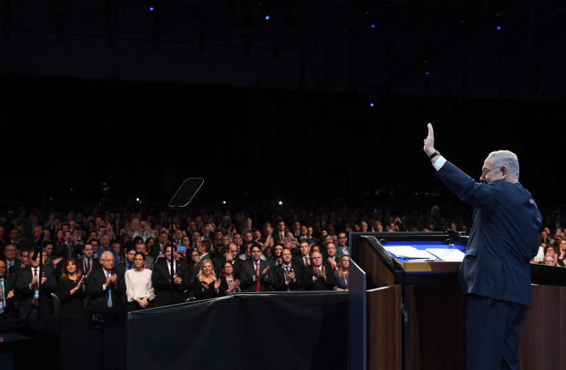Prime Minister Benjamin Netanyahu addressing the 2018 AIPAC conference (photo credit: CHAIM ZACH / GPO)