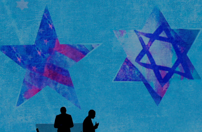 Crews prepare for the speakers at the AIPAC policy conference in Washington, DC, U.S., March 6, 2018. (photo credit: REUTERS/BRIAN SNYDER)