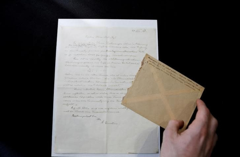 """A letter written by Albert Einstein in 1928, in which according to the auction house he outlined ideas for his """"Third Stage of the Theory of Relativity"""", is seen before it is sold at an auction in Jerusalem, March 6, 2018 (photo credit: REUTERS/Ronen Zvulun)"""