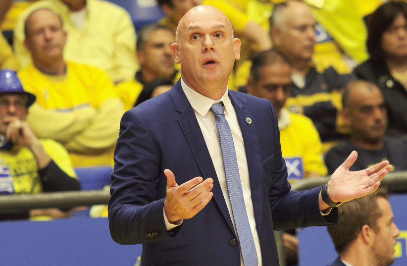 Maccabi Tel Aviv coach Neven Spahija will need to find answers for his team's recent struggles very soon or the yellow-and-blue will be facing another lost season (photo credit: ADI AVISHAI)