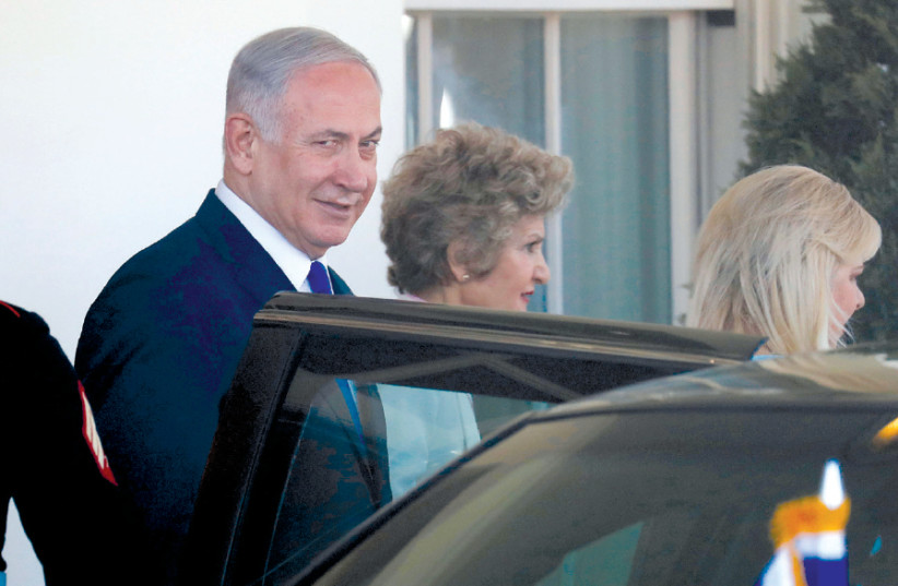 PRIME MINISTER Benjamin Netanyahu and his wife, Sara, (right) depart from the White House  (photo credit: REUTERS/LEAH MILLIS)