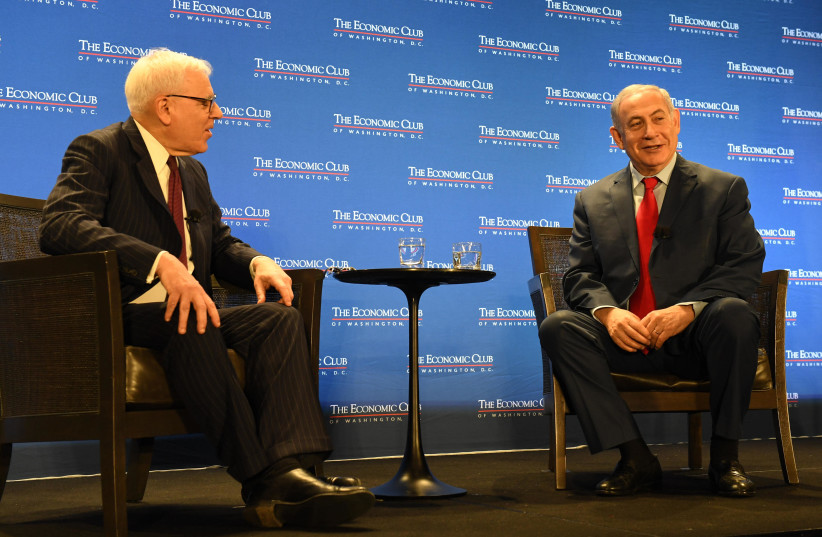 Prime Minister Benjamin Netanyahu in an onstage interview with David Bloomberg at the Economic Club in Washington D.C, March 2018 (photo credit: CHAIM TZACH/GPO)