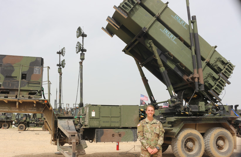 Second Lt. Jennifer Slade stands in front of an Air Defense Delta Battery (photo credit: ANNA AHRONHEIM)