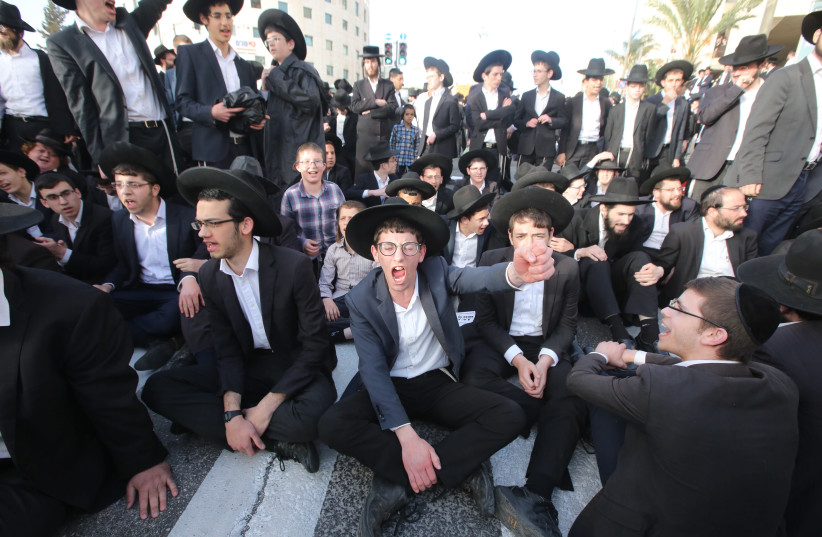 Young haredim take part in a protest against mandatory IDF conscription, March 2018 (photo credit: MARC ISRAEL SELLEM/THE JERUSALEM POST)