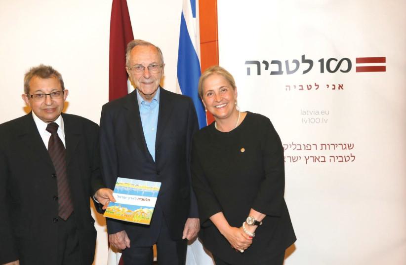 Moshe Arens, flanked by Eliahu Valk and Latvian Ambassador to Israel Elita Gavel (photo credit: SIVAN FARAG)