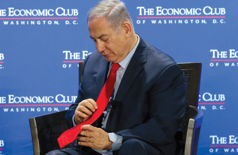 ME MINISTER Benjamin Netanyahu pauses during an interview at the Economic Club of Washington, DC, on March 7, 2018. (photo credit: REUTERS)