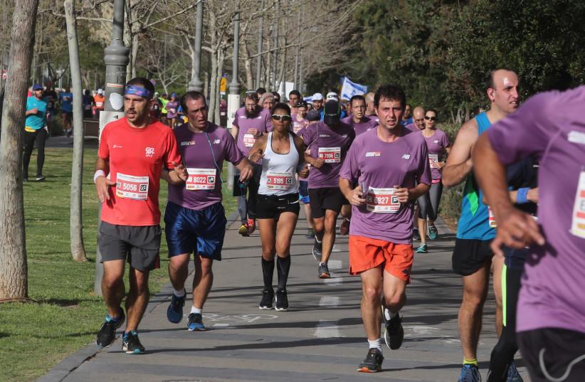 Runners participate in the Jerusalem marathon, March 2018 (photo credit: MARC ISRAEL SELLEM/THE JERUSALEM POST)