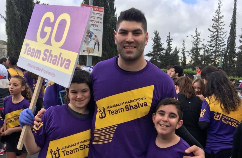 Israeli Olympian Ori Sasson runs with Team Shalva at the Jerusalem Marathon, March 2018 (photo credit: SHALVA)