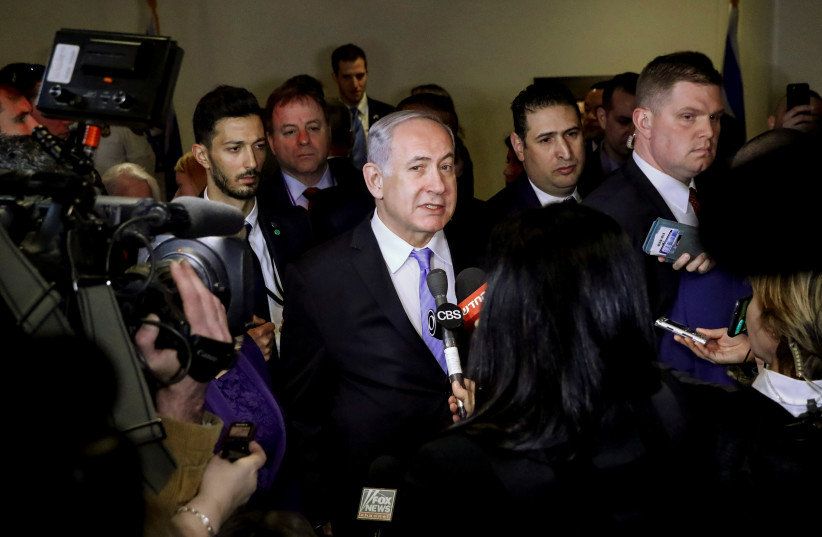 Israeli Prime Minister Benjamin Netanyahu speaks to the press during the opening of a special exhibit on Jewish presence in Jerusalem at the United Nations Headquarters in New York City, U.S., March 8, 2018. (photo credit: REUTERS/BRENDAN MCDERMID)