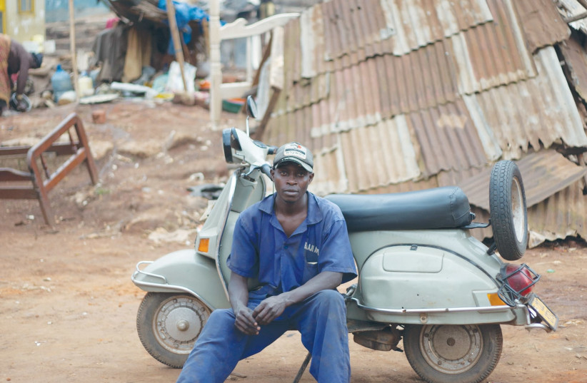 A work from 'Uganda's Vespa Club' (photo credit: ARIEL TAGAR)