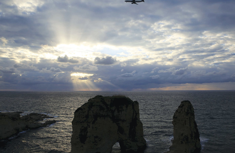 An airplane flies out of Beirut's International Airport. (photo credit: REUTERS)