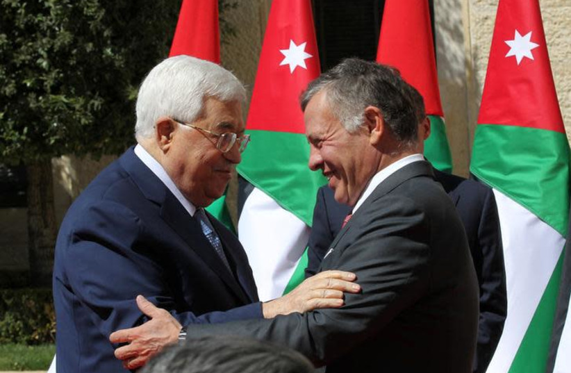 Jordan's King Abdullah meets Palestinian president Mahmoud Abbas at the Royal Palace in Amman, Jordan March 12, 2018.  (photo credit: REUTERS/MOHAMMAD ABU GHOSH/POOL)