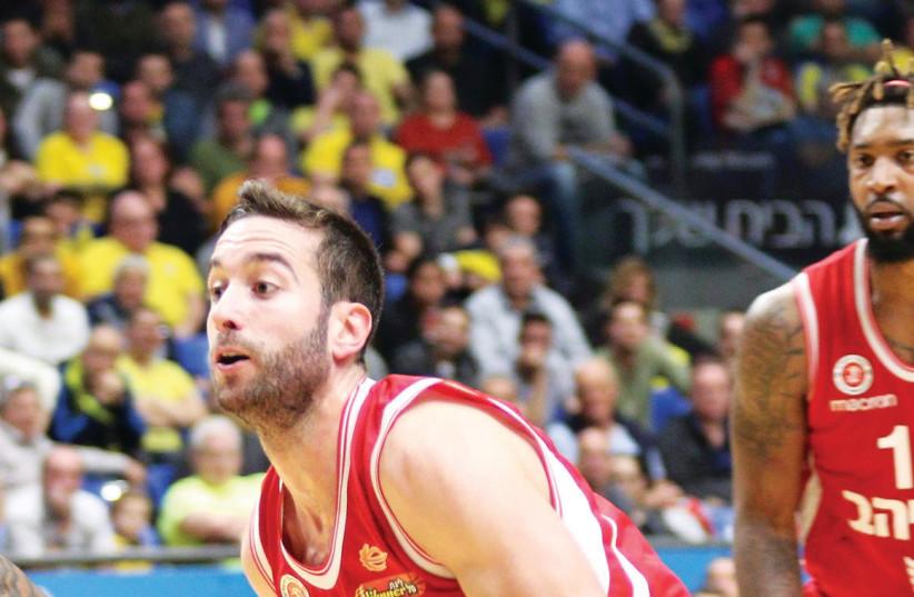 Hapoel Jerusalem guard Yogev Ohayon won't play again this season after injuring his wrist during the defeat to Maccabi Tel Aviv on Sunday (photo credit: ADI AVISHAI)