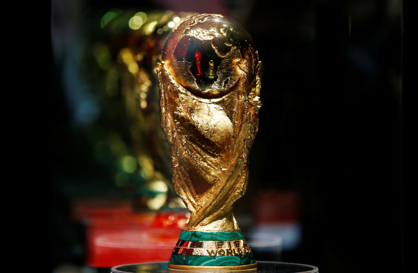 The FIFA world cup trophy is displayed during the Fifa World Cup Trophy Tour, in Amman, Jordan February 20, 2018.  (photo credit: REUTERS/MUHAMMAD HAMED)