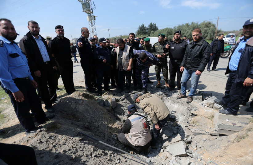 Hamas police chief Tayseer al-Batish inspects the site of an explosion that targeted the convoy of Palestinian Prime Minister Rami Hamdallah, in the northern Gaza Strip (photo credit: IBRAHEEM ABU MUSTAFA / REUTERS)