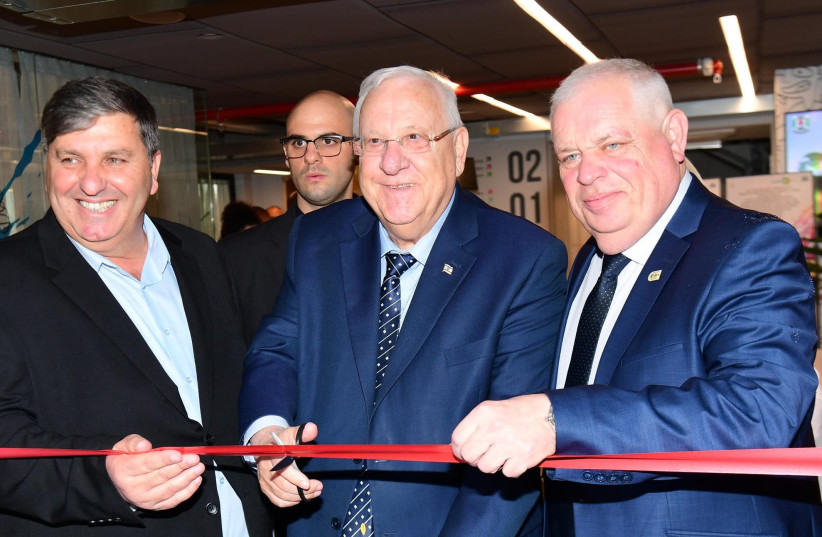 President Reuven Rivlin cuts the ribbon at the unveiling of a new JNF-KKL school in Upper Nazareth, Israel, March 2018 (photo credit: AMOS BEN-GERSHOM/GPO)