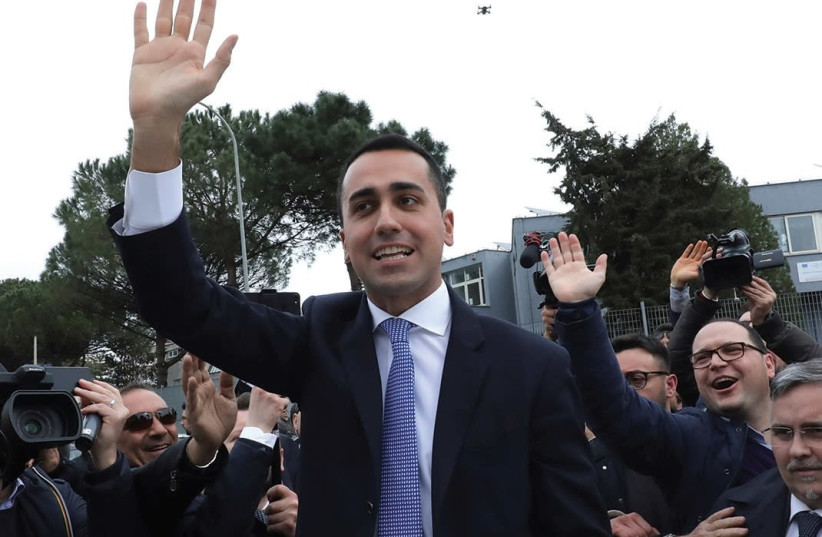 5-STAR MOVEMENT leader Luigi Di Maio waves as he leaves after casting his vote at a polling station in Pomigliano d'Arco, Italy. (photo credit: REUTERS)