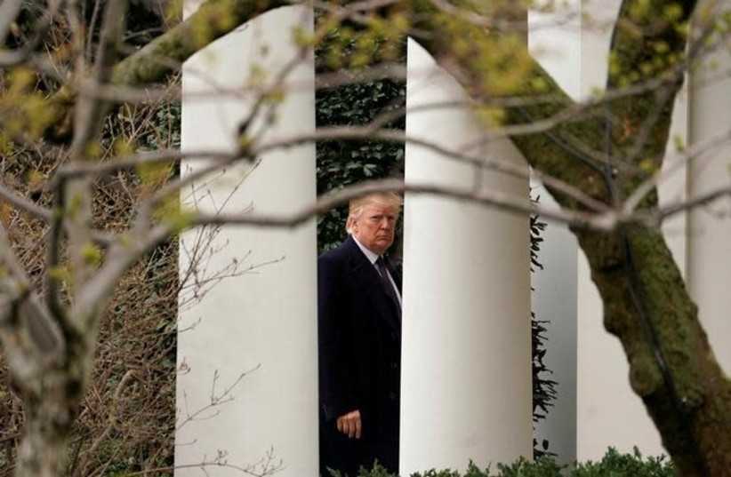 US President Donald Trump returns to the White House (photo credit: KEVIN LAMARQUE/REUTERS)
