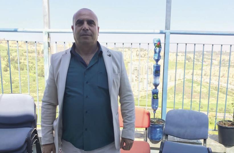 Ramadan Dabash poses at the Sur Baher community center on Monday (photo credit: UDI SHAHAM)