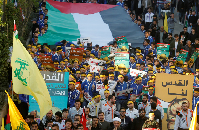 Supporters of Lebanon's Hezbollah protest in Beirut's southern suburbs, Lebanon (photo credit: AZIZ TAHER/REUTERS)