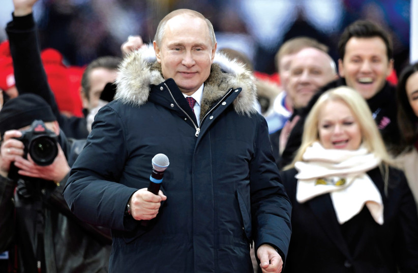 RUSSIAN PRESIDENT Vladimir Putin attends an election rally earlier this month (photo credit: REUTERS)