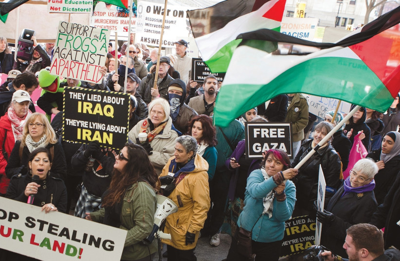 PROTESTERS ATTEND an anti-AIPAC rally in 2012 (photo credit: REUTERS)